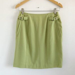 lime green mini skirt with buckles